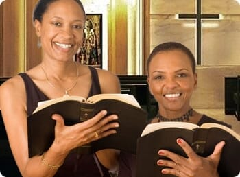 2 women reading the bible in church